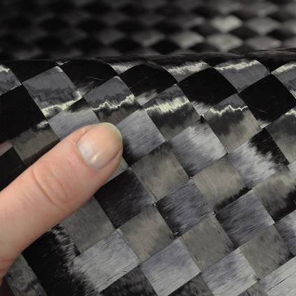 15mm Spread-Tow Plain Weave Carbon Fibre Cloth In Hand Closeup