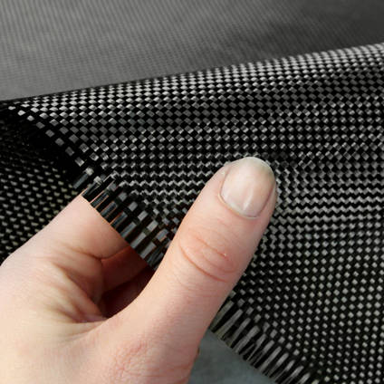 210g Plain Weave 3k Carbon Fibre Cloth In Hand Closeup