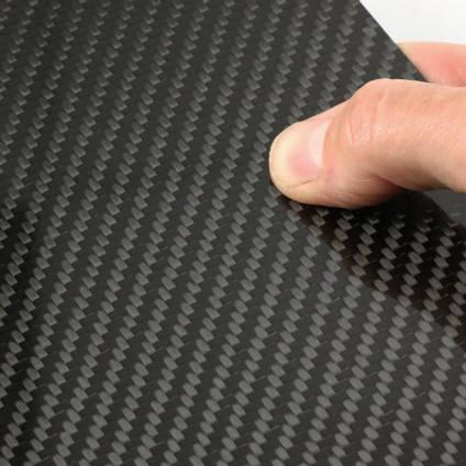 High Strength Carbon Fibre Sheet in Hand Closeup