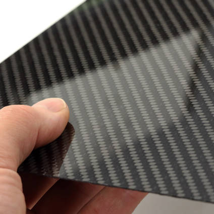 High Strength Carbon Fibre Sheet in Hand with Reflection