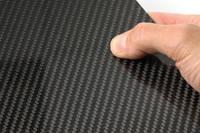 High Strength Carbon Fibre Sheet in Hand Closeup Thumbnail