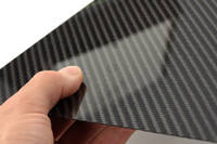 High Strength Carbon Fibre Sheet in Hand with Reflection Thumbnail