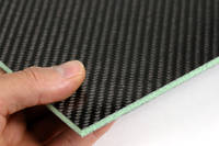 Foam Cored Carbon Fibre Panel in Hand Closeup Thumbnail